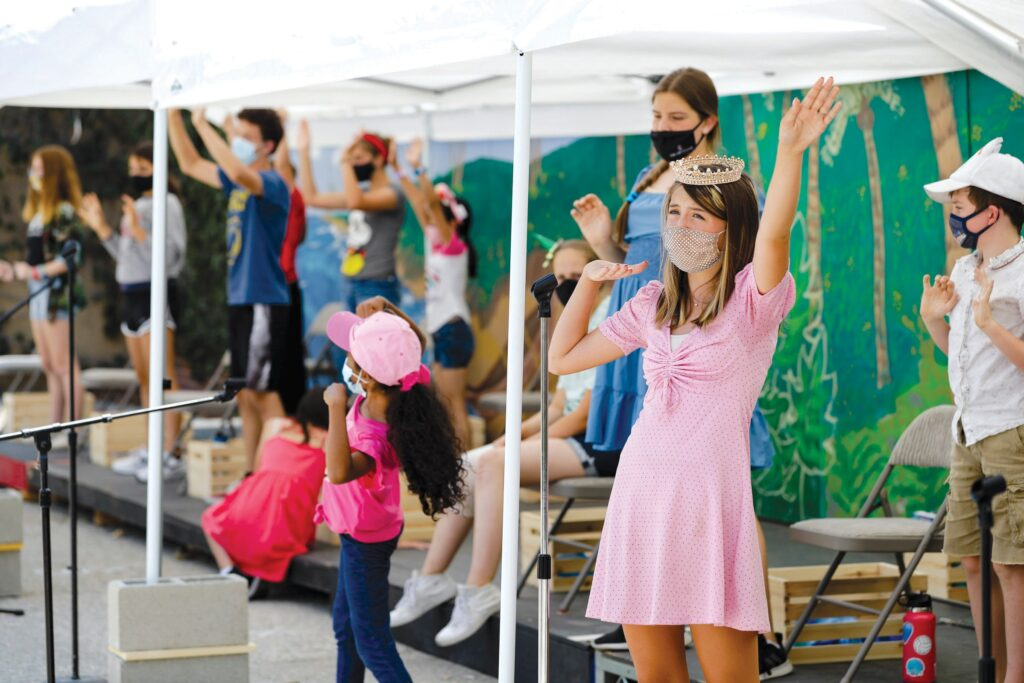 """PRACTICE MAKES PERFECT—Chloé Aguirre, 13, who plays Tama Toa, sings with cast members during a rehearsal of """"Moana Jr."""" on July 15 at High Street Arts Center's Summer Youth Camp in Moorpark. MICHAEL COONS/Acorn Newspapers"""
